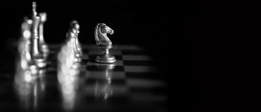 Pieces on chess board for playing game and strategy stock image