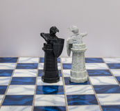 A pieces of chess character on the board with a light. A character represents strategy, planning, brave, betrayal, confrontation a Royalty Free Stock Photo