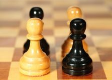Pieces on a chessboard Stock Photos