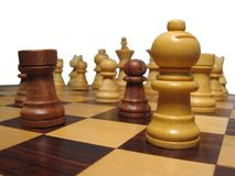 Pieces on chessboard. With isolated background stock photography