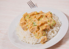 Pieces of chicken fillet and cheese sauce with rice Royalty Free Stock Images