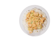 Pieces of chicken fillet and cheese sauce with rice. top view. isolated Royalty Free Stock Image