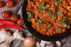 Pieces of chicken fillet in curry sauce top view close-up Stock Image