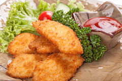 Pieces of chicken fried in batter. Royalty Free Stock Photography
