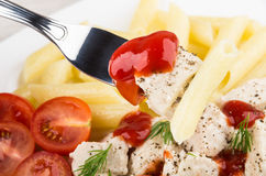 Pieces of chicken, pasta and tomatoes on fork Royalty Free Stock Photo