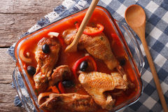 Pieces of chicken stewed in tomato sauce close-up. Horizontal to Stock Photo