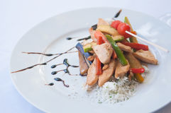 Pieces of chicken with vegetables Stock Photo