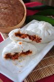 Pieces of Chinese Red Pork Bun. On white plate Royalty Free Stock Photos