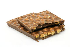Pieces of chocolate. Big pieces of chocolate filled with hazelnuts Royalty Free Stock Photography