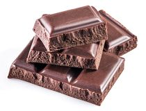 Pieces of chocolate bar isolated on a white. Royalty Free Stock Photos