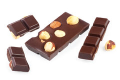 Pieces of chocolate bar with nuts Royalty Free Stock Images