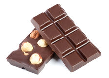 Pieces of chocolate bar with nuts Royalty Free Stock Photos