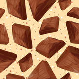 Pieces of chocolate on a beige background Stock Photography