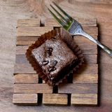 Pieces of chocolate brownie on a wooden with fork Royalty Free Stock Photos