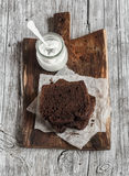 Pieces of chocolate cake and greek natural yogurt on a wooden cutting board Royalty Free Stock Photography