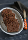 Pieces of chocolate cake on the oval dish Stock Images