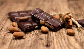Pieces of chocolate and cinnamon Royalty Free Stock Image