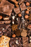 Pieces of chocolate, cookies, nuts Royalty Free Stock Images