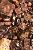 Pieces of chocolate, cookies and nuts Stock Photo