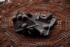 Pieces of chocolate on a crocheted napkin Stock Photos