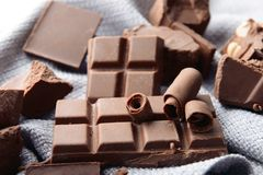 Pieces of chocolate with curls on napkin stock photo