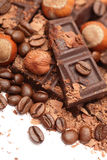 Pieces of chocolate with hazelnuts and coffee beans Royalty Free Stock Photos