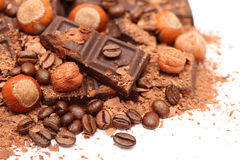 Pieces of chocolate with hazelnuts and coffee beans Stock Photography