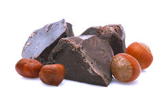 Pieces of chocolate with hazelnuts. Stock Photography