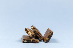 Pieces of chocolate with nuts. Royalty Free Stock Photography