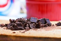 Pieces of chocolate. With red background Stock Photos