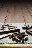 Pieces of chocolate on slate plate with copy space Royalty Free Stock Images