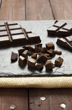 Pieces of chocolate on slate plate Stock Photography