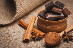 Pieces of chocolate with spices, cinnamon, star Royalty Free Stock Image