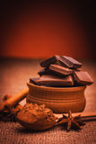 Pieces of chocolate with spices, cinnamon, star Royalty Free Stock Photography