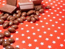 Pieces of chocolates on red background Royalty Free Stock Photo