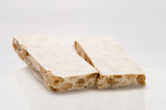 Hard almond nougat on white plate Stock Images
