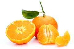 Pieces of a clementine. Different pieces of a clementine on white background stock images