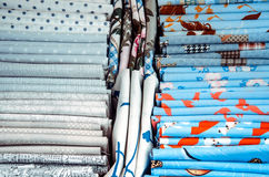 Pieces of cloth on the market. Fabric pieces of tailoring cloth on the market with different colors. Blue and white cloth Royalty Free Stock Photos