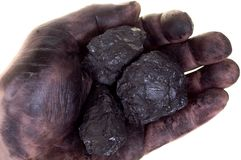 Pieces of coal in dirty palm Royalty Free Stock Image