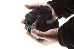 Pieces of coal in hand isolated on white Royalty Free Stock Photo