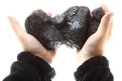 Pieces of coal in hand isolated on white background Stock Photos