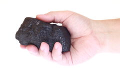 Pieces of coal in palm Stock Image