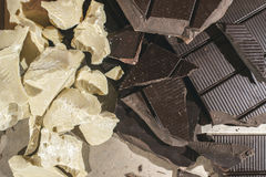 Pieces of cocoa butter and chocolate Royalty Free Stock Images