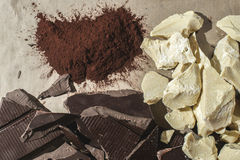 Pieces of cocoa butter and chocolate Stock Photos