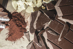 Pieces of cocoa butter and chocolate Royalty Free Stock Image