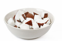Pieces of coconut in a bowl Stock Photos