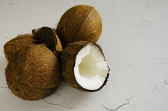 Pieces of coconut on white background, flat lay, top view stock images