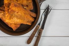 Pieces of cod in breadcrumbs. Pieces of cod in breadcrumbs on a ceramic pan. Top view Stock Photos