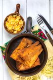 Pieces of cod in breadcrumbs. Pieces of cod in breadcrumbs on a ceramic pan. Top view Stock Photography