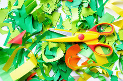 Pieces of colored paper and scissors Stock Images